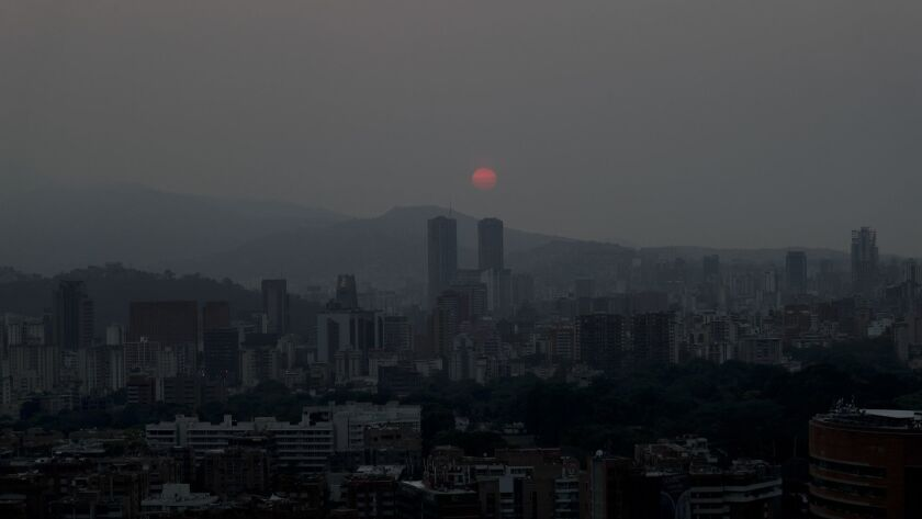 The sun sets over Caracas, Venezuela on March 26, 2019. Much of Venezuela remained without electricity Tuesday.