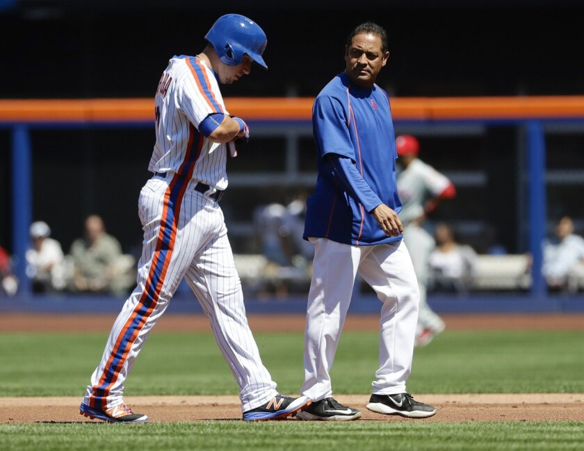 A trainer walks New York Mets' Asdrubal Cabrera, left, off the field due to an injury during the first inning of a baseball game against the Philadelphia Phillies, Sunday, Aug. 28, 2016, in New York. (AP Photo/Frank Franklin II)
