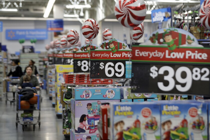 FILE - This Wednesday, Oct. 26, 2016, file photo, shows prices in the toy section at Walmart in Tete