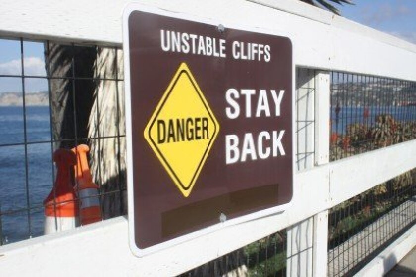 """City workers placed tape over a portion of this sign above La Jolla Cove that once read """"No Public Access."""" Ashley Mackin photo"""
