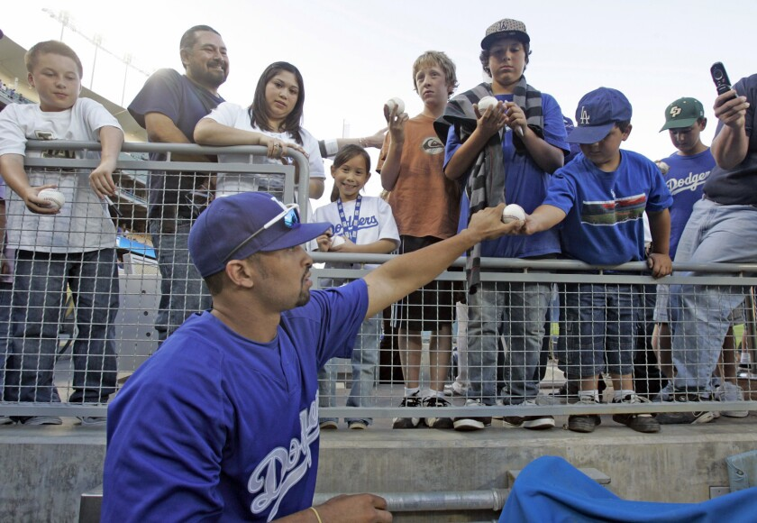 Fans get autographs from Dodgers Matt Kemp before the game against the Padres at Dodger Stadium on April 11, 2008.
