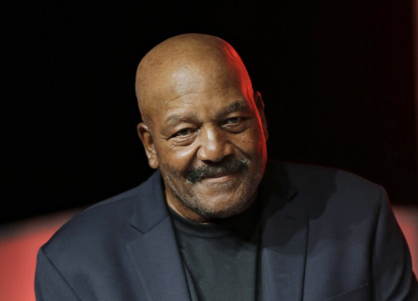 FILE - In this April 4, 2015, file photo, former Cleveland Browns running back Jim Brown is introduced during the new uniform unveiling in Cleveland. The greatest Cleveland Brown of them all is being immortalized.  Hall of Fame running back Jim Brown, one of the most dominant players in NFL history