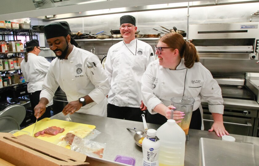 Chef instructor Megan Leppert shares a laugh with students Samuel Yador (left) and Jeff Lenzkes.