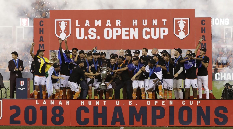Houston Dynamo players celebrate after the U.S. Open Cup championship soccer match against the Philadelphia Union Wednesday, Sept. 26, 2018, in Houston. Houston Dynamo won 3-0. (AP Photo/David J. Phillip)