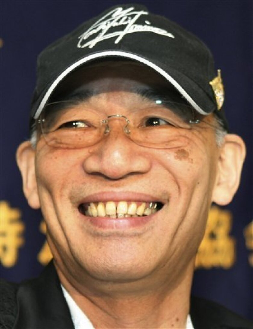 Yoshiyuki Tomino, executive director and creator of Gundam animation series, smiles during a press conference in Tokyo Tuesday, July 7, 2009. Gundam that features giant robots in the era of space wars, is turning 30 this year and the reality is finally beginning to catch up with its world set in distant future, addressing issues ranging from environment to global conflicts, he said. (AP Photo/Koji Sasahara)