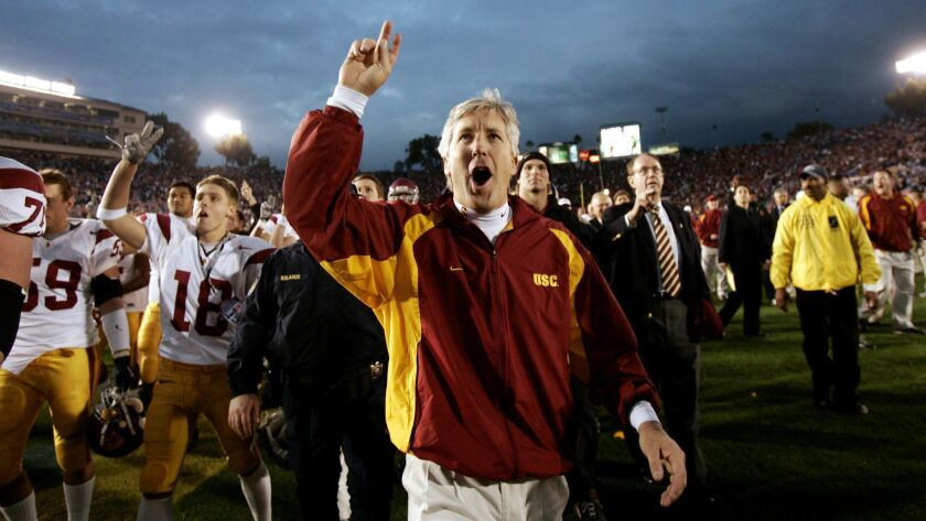 Then-USC coach Pete Carroll celebrates after the Trojans defeated UCLA 29-24 at the Rose Bowl on Dec. 4, 2004.