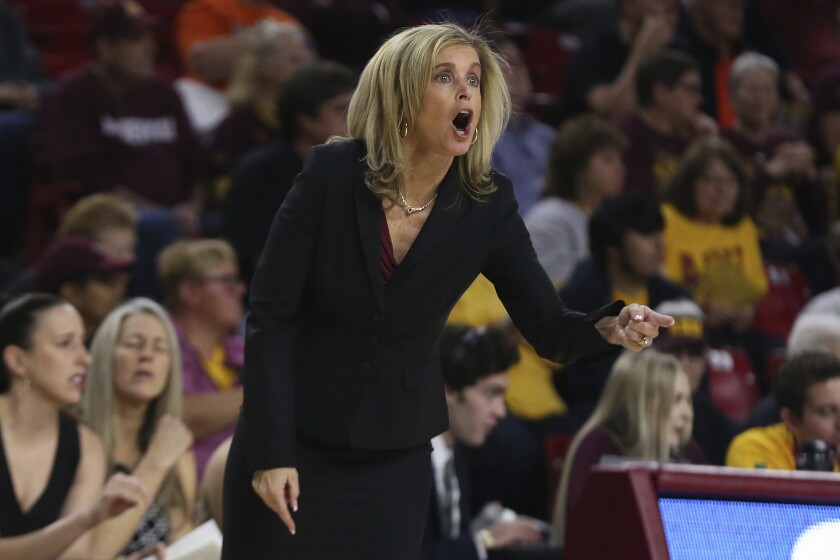 Arizona State head coach Charlie Turner Thorne shouts instructions to her team as they play Oregon State during the first half on Sunday in Tempe, Ariz.