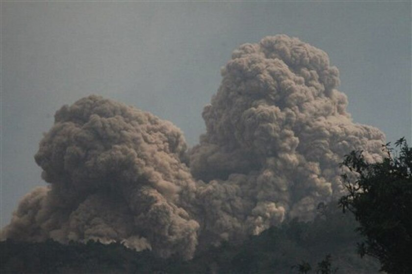 Mount Rokatenda spews volcanic material as it erupts on Palue island, Indonesia, Sunday, Aug. 11, 2013. Nearly 3,000 people have been evacuated from the island, according to the National Disaster Mitigation Agency. The volcano has been rumbling since last October. (AP Photo)