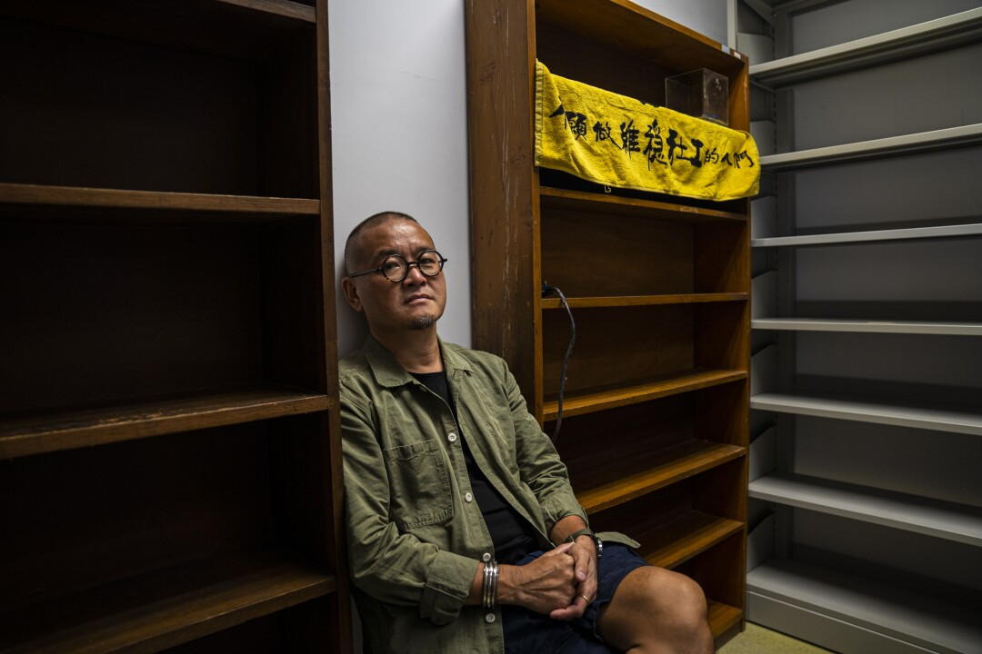 Social work lecturer Shiu Ka-chun sits in his empty office at Hong Kong Baptist University.