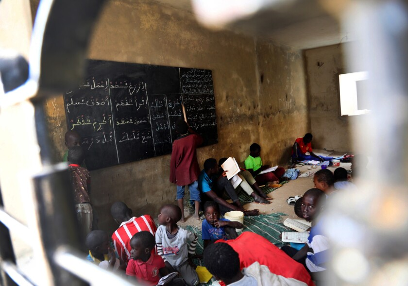 Talibes learning at a daara in the Keur Massar suburb of Dakar.