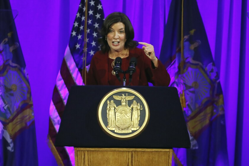 FILE - In this Jan. 1, 2019 file photo, New York Lt. Gov. Kathy Hochul delivers her remarks after taking the oath of office, on Ellis Island in New York Harbor. As a chorus of top Democrats demanded Gov. Andrew Cuomo's resignation over sexual harassment allegations last week, Hochul, who would succeed him if he stepped down, did what she's done for most of her time in office: Kept a discreet profile. (AP Photo/Richard Drew, File)