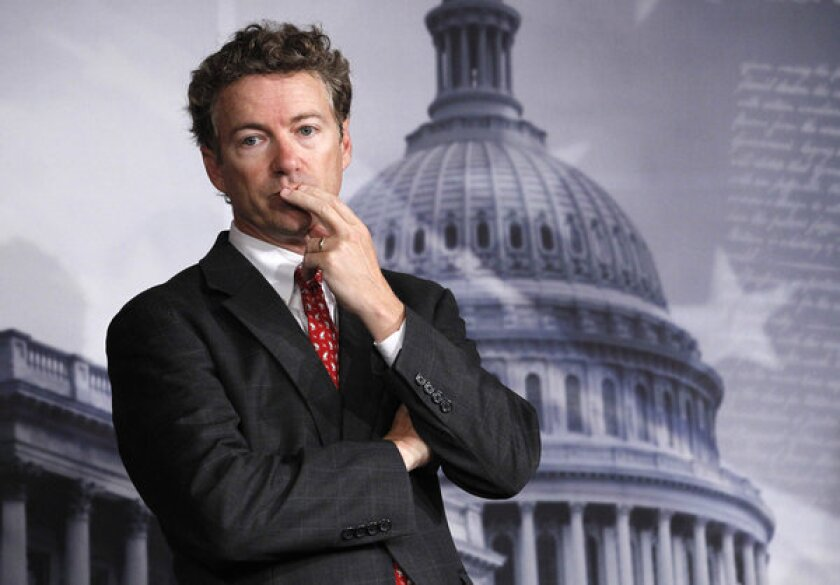 Sen. Rand Paul (R-Ky.) listening to a question during a news conference on Capitol Hill.