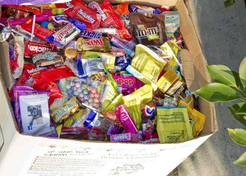 Extra Halloween candy collected at Dr. Curtis Chan's dental office will be donated to the Marines for Operation Gratitude