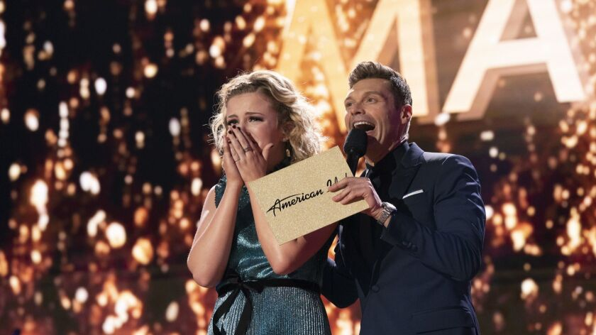 """In this May 21, 2018 photo provided by ABC, Maddie Poppe, left, reacts with Ryan Seacrest after she was announced the winner of this year's """"American Idol"""" in Los Angeles."""