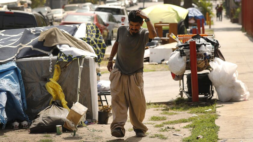 LOS ANGELES, CA – JUNE 21, 2018: Pablo Rivera Gomez, 39, outside his tent, one of several shared