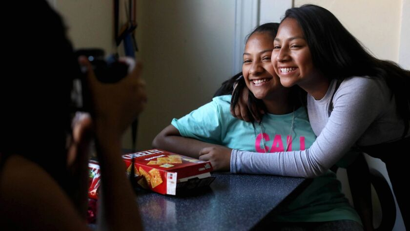 LOS ANGELES, CALIF. -- SATURDAY, APRIL 14, 2018: Ellie Perez,16, left, photographs sisters Maquisha,