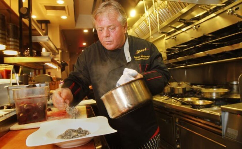 Executive chef Eugenio Martignago in his open kitchen at West Steak & Seafood in Carlsbad.