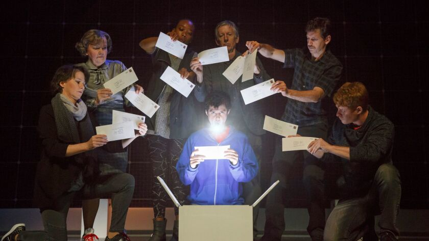 "Adam Langdon as Christopher Boone, center, with the cast of the touring production of ""The Curious I"