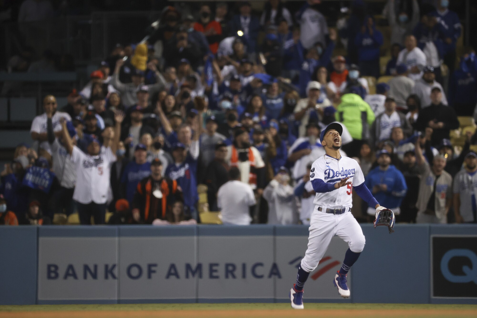 Los Angeles Dodgers right fielder Mookie Betts calls for a pop fly by San Francisco Giants' Donovan Solano