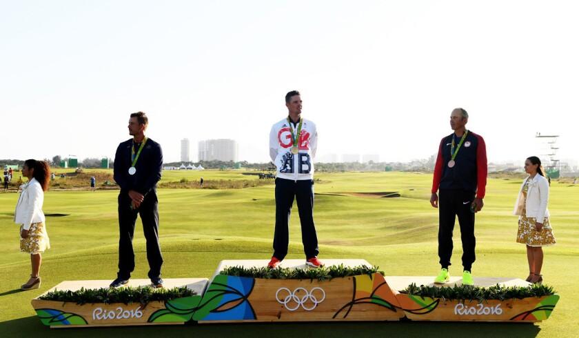 Gold medal winner Justin Rose of Great Britain, center, is flanked by silver medalist Henrik Stenson of Sweden, left, bronze medalist Matt Kuchar of the U.S. after receiving the medals.