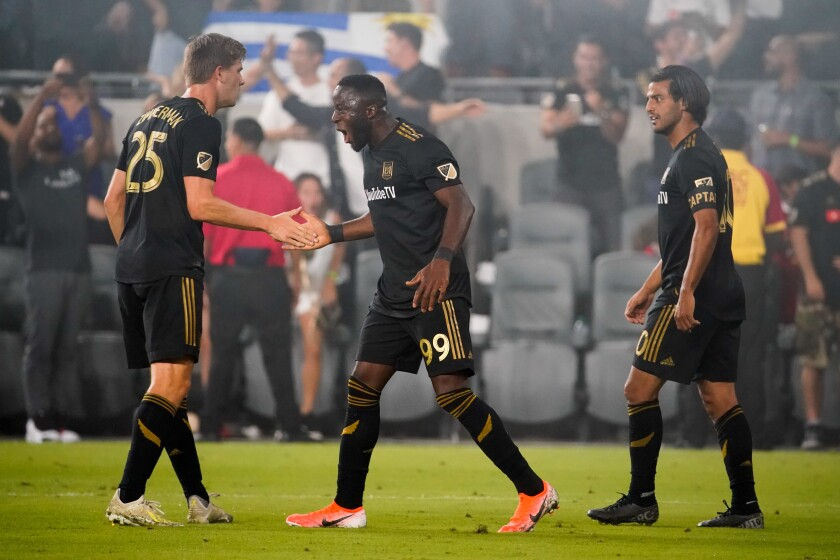 LAFC forward Adama Diomande, center, celebrates with teammates after scoring against the Galaxy on Thursday.