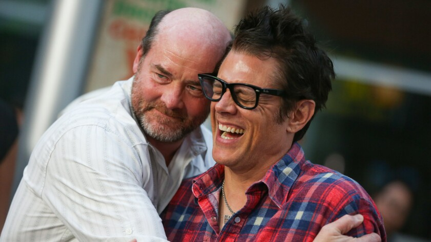 "David Koechner, left, and Johnny Knoxville arrive at the Los Angeles premiere of ""Being Evel"" in Los Angeles."