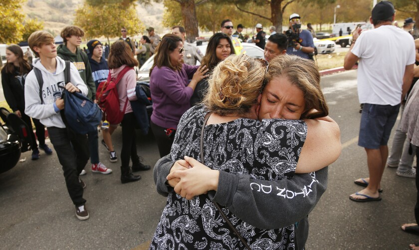 Students and family members leave Central Park in Santa Clarita