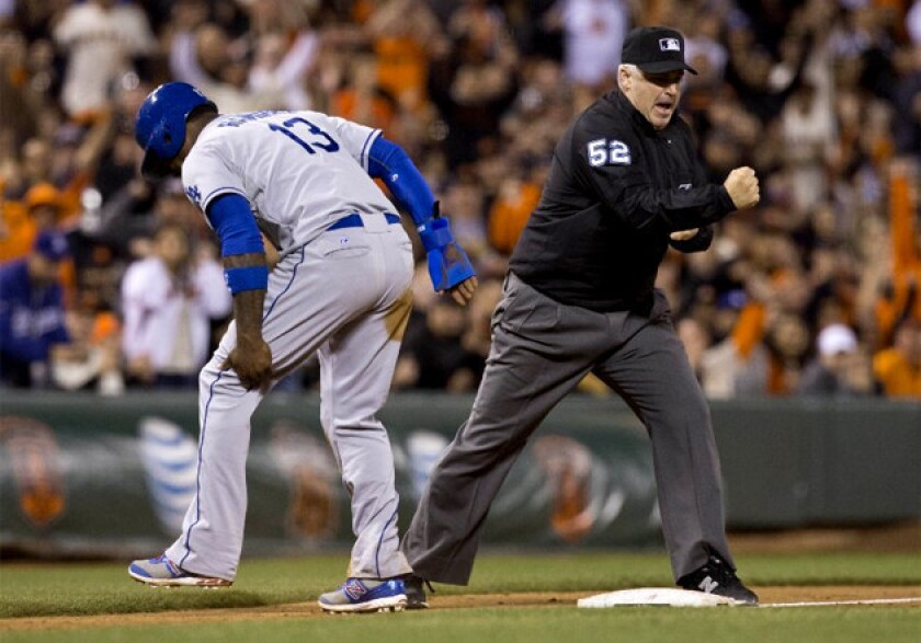 Dodgers' Hanley Ramirez limps off the field after he injured his hamstring in the sixth inning.