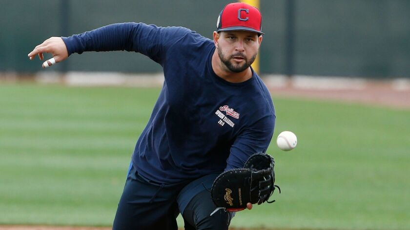 FILE - In this Feb. 16, 2018, file photo, Cleveland Indians first baseman Yonder Alonso gets ready t
