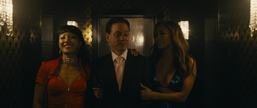 "Constance Wu and Jennifer Lopez in ""Hustlers"""