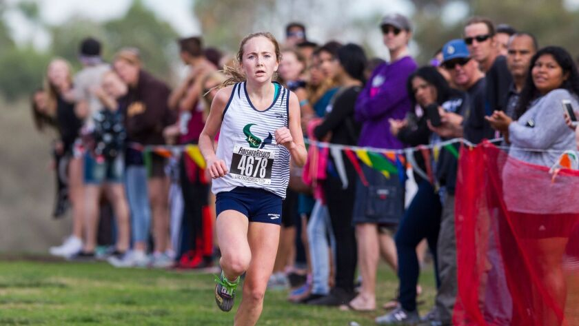La Costa Canyon's Kristin Fahy approaches the finish line to take the win in the girls division III finals.