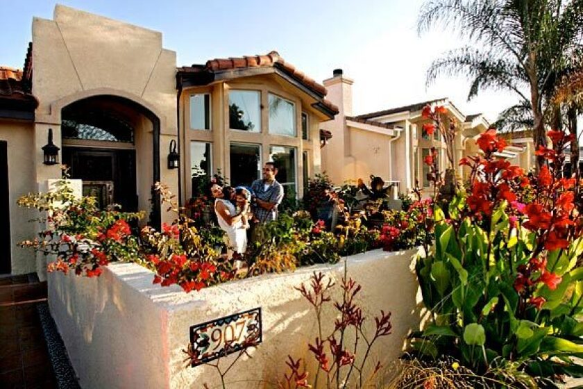 """By Eric Ducker Christopher Portugal describes the original look of his home as """"California no-style."""" The 2,500-square-foot house was built in 2004 on a 10,000-square-foot hillside lot in San Pedro. It was, he says, """"just an amalgamation of random stucco and tile that you see springing up everywhere, with no general architectural direction or proper contractor supervision."""" Portugal bought the home when it was in the early stages of construction and moved in with his wife, Ritu, after their honeymoon. They soon started seeing small problems, and when the rainstorms caused flooding, they realized how seriously flawed the building was. """"When we moved in, we were looking forward to getting on with our lives,"""" says Portugal, who records under the name Thes One and is a member of the hip-hop duo People Under the Stairs. """"I was thinking about touring. I was thinking about doing music."""" Instead, he immersed himself in fixing up their house, though he had no prior home improvement experience. """"It was very dramatic, those first two years. Then I realized I liked doing it,"""" he says. """"I liked being outside and being involved with the construction."""" Take a peek inside the latest installment of our Backstage Pass series on the homes of Southern California's music industry -- homes as entertaining as the personalities on stage and behind the scenes."""