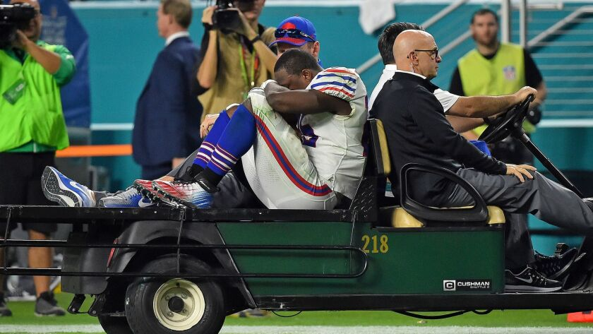Bills running back LeSean McCoy is carted off the field after being injured against the Dolphins.