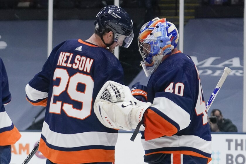 New York Islanders' Brock Nelson (29) celebrates with goaltender Semyon Varlamov (40) after an NHL hockey game against the Washington Capitals Tuesday, April 6, 2021, in Uniondale, N.Y. The Islanders won 1-0. (AP Photo/Frank Franklin II)