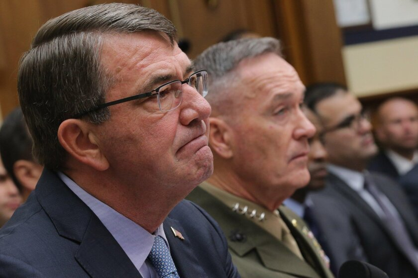 Defense Secretary Ashton Carter, left, and Chairman of the Joint Chiefs of Staff Gen. Joseph Dunford Jr. testify before the House Armed Services Committee in the Rayburn House Office Building on Capitol Hill December 1, 2015 in Washington, DC.