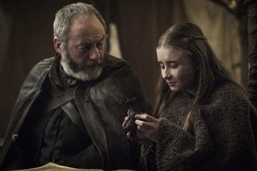 "Liam Cunningham as Davos Seaworth and Kerry Ingram as Princess Shireen in ""Game of Thrones."""