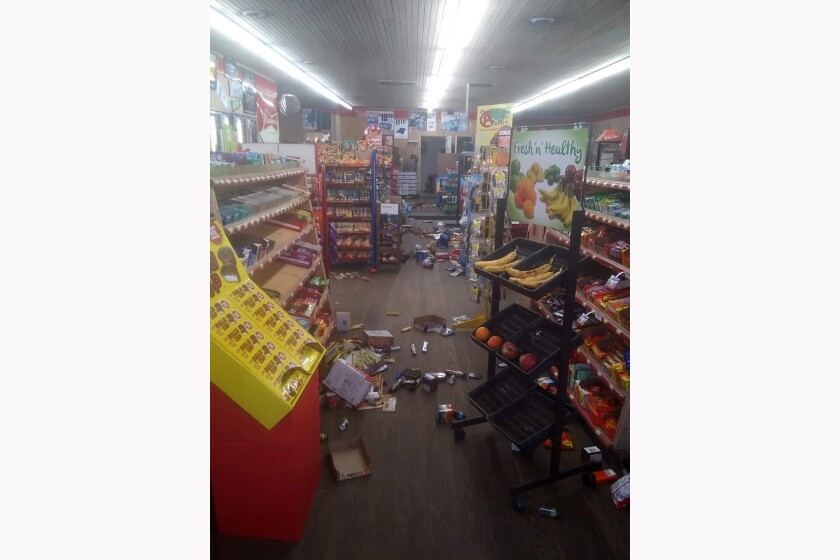Various items litter the floor of the 4 Brothers Store in Sparta, N.C., after an earthquake.