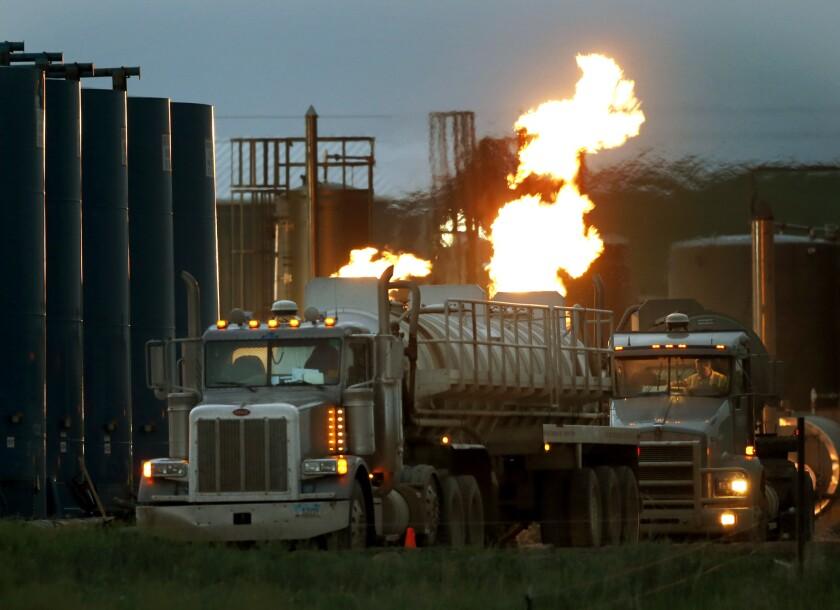 APphoto_APTOPIX Oil Boom Photo Gallery