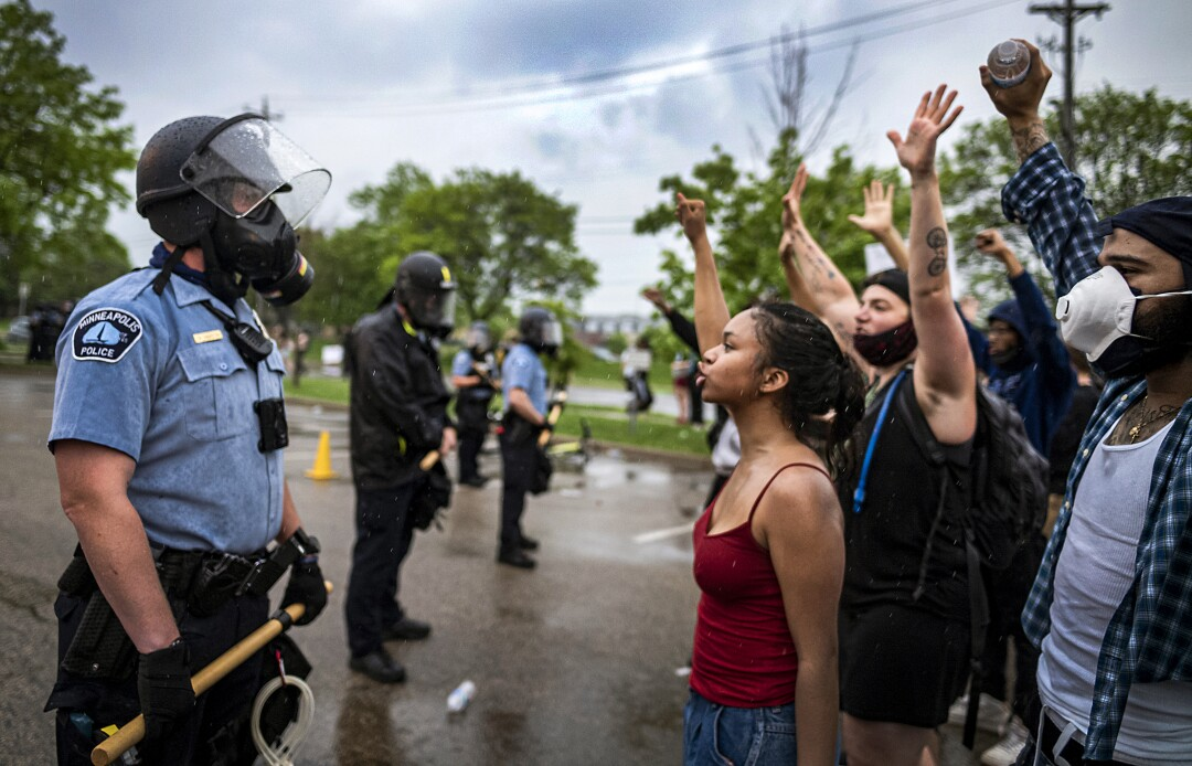 Protesters and police face each other during a rally in Minneapolis after the death of George Floyd.