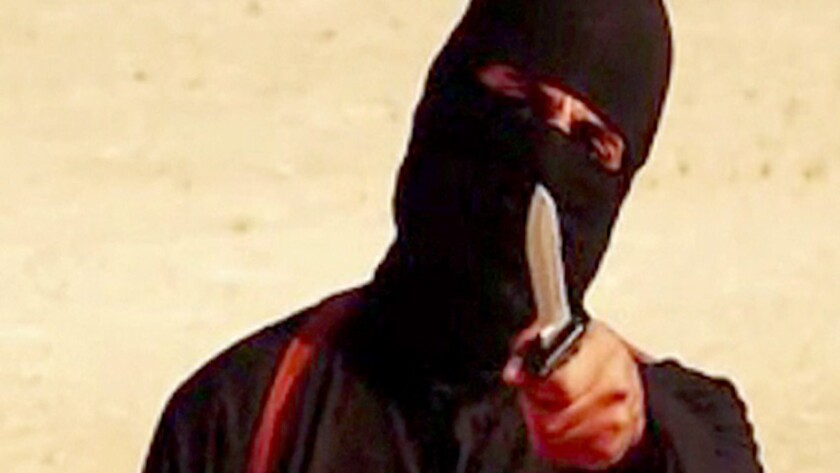 """A frame from a video released by Islamic State shows the masked militant """"Jihadi John"""" before beheading U.S. hostage Steven Sotloff."""