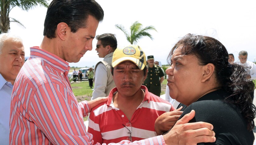 Mexican President Enrique Pena Nieto, right, meets Rebeca Ramirez and Francisco Javier Mendez, the parents of a 12-year-old boy who died of injuries sustained in a beating by classmates in Tamaulipas.