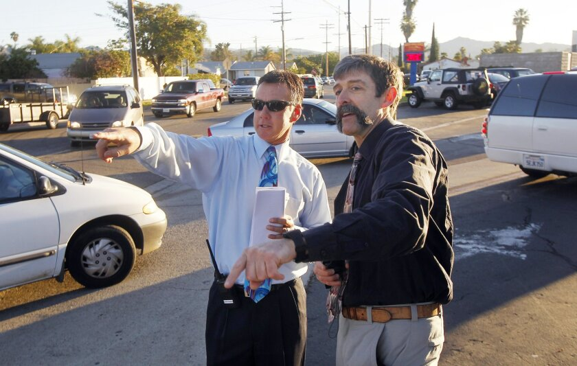 Consultant Mark Fenton (right) talks with Mission Middle School Principal Jon Centofranchi before school along East Mission Avenue earlier this month in Escondido.