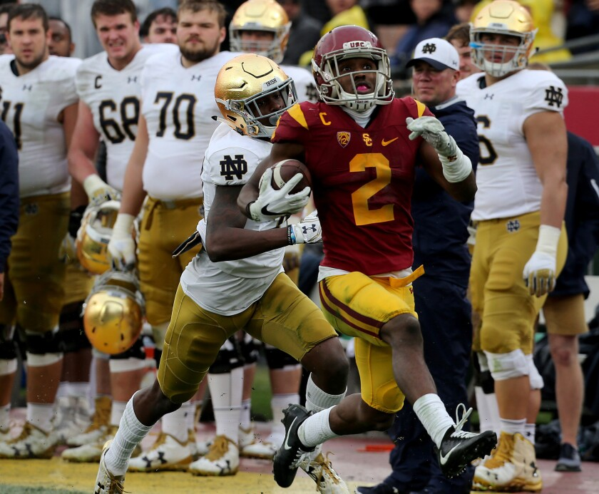 USC cornerback Adoree' Jackson returns a punt 55 yards for a touchdown against Notre Dame in the second quarter of a game Saturday.