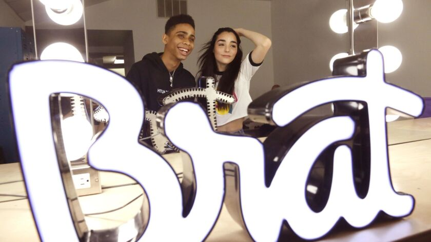 """Actor Bryce Xavier, 16, left, of the Brat show """"Total Eclipse,"""" and actress Indiana Massara, 15, of """"Chicken Girls,"""" in the makeup room at the digital video company Brat in Los Angeles."""