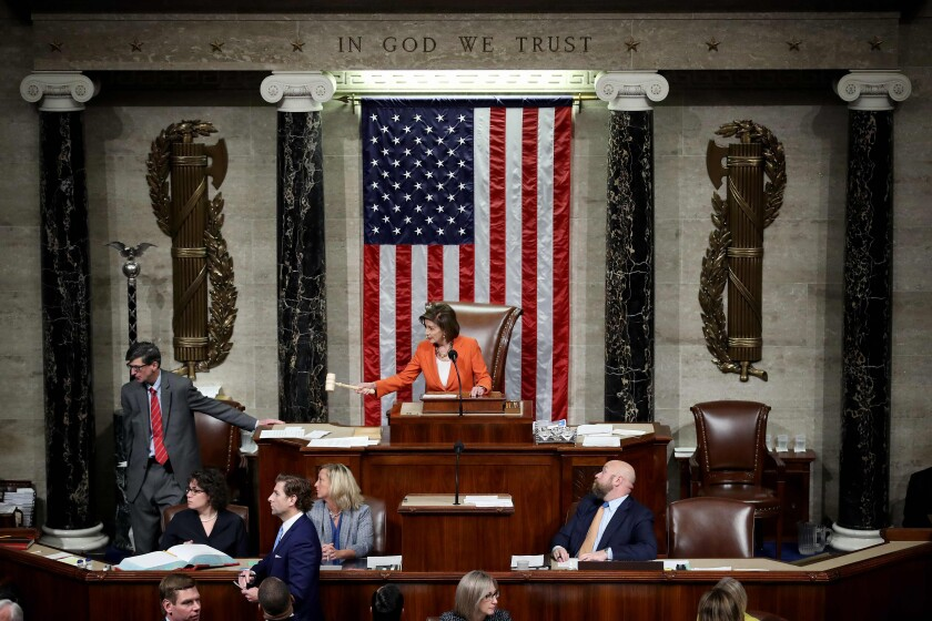 House Speaker Nancy Pelosi (D-San Francisco) gavels to a close Thursday's vote by the House of Representatives on a resolution formalizing the impeachment inquiry of President Trump.