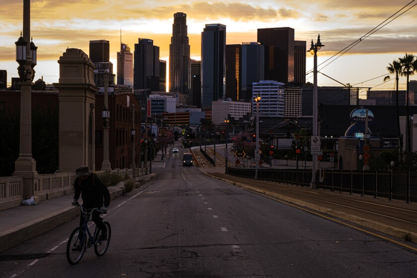 A view of downtown L.A. at dusk Monday, from 1st Street Bridge near Boyle Heights.