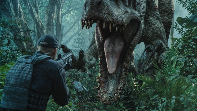 """Indominus rex moves in for the attack in a scene from """"Jurassic World."""""""