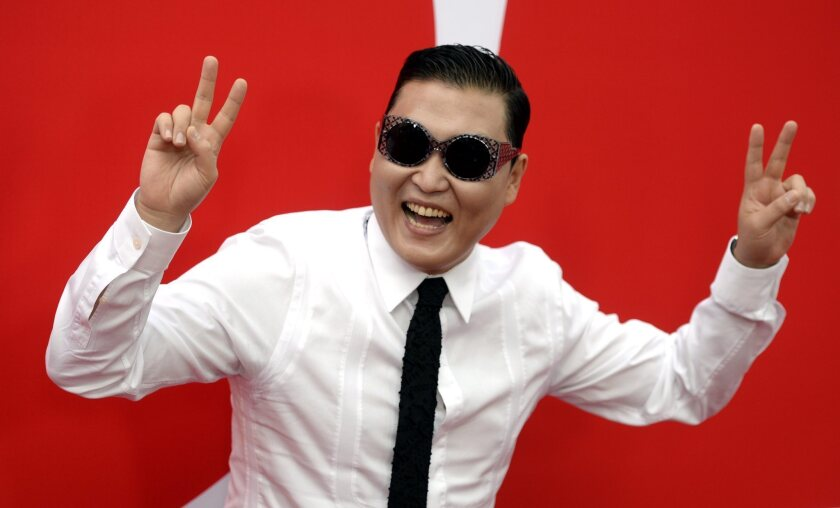 """Psy, pictured with talent manager Scooter Braun, said he might retire his hit song """"Gangnam Style."""""""