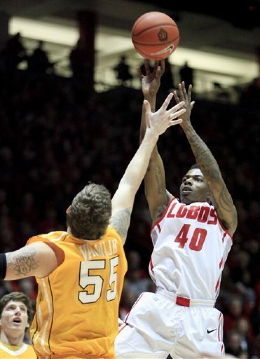 New Mexico's Demetrius Walker shoots over Valparaiso's Kevin Van Wijk (55) during the first half of an NCAA college basketball game at University Arena in Albuquerque, N.M., Saturday, Dec. 8, 2012. (AP Photo/Craig Fritz)