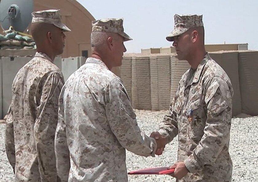 Marine Warrant Officer John W. Hermann (right) is awarded the Silver Star by Brig. Gen. Charles Hudson Thursday at Forward Operating Base Delaram II in Afghanistan.